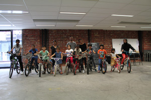 Ten happy clients on their donated bikes.