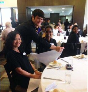 AMES students practising silver service at William Angliss Institute.